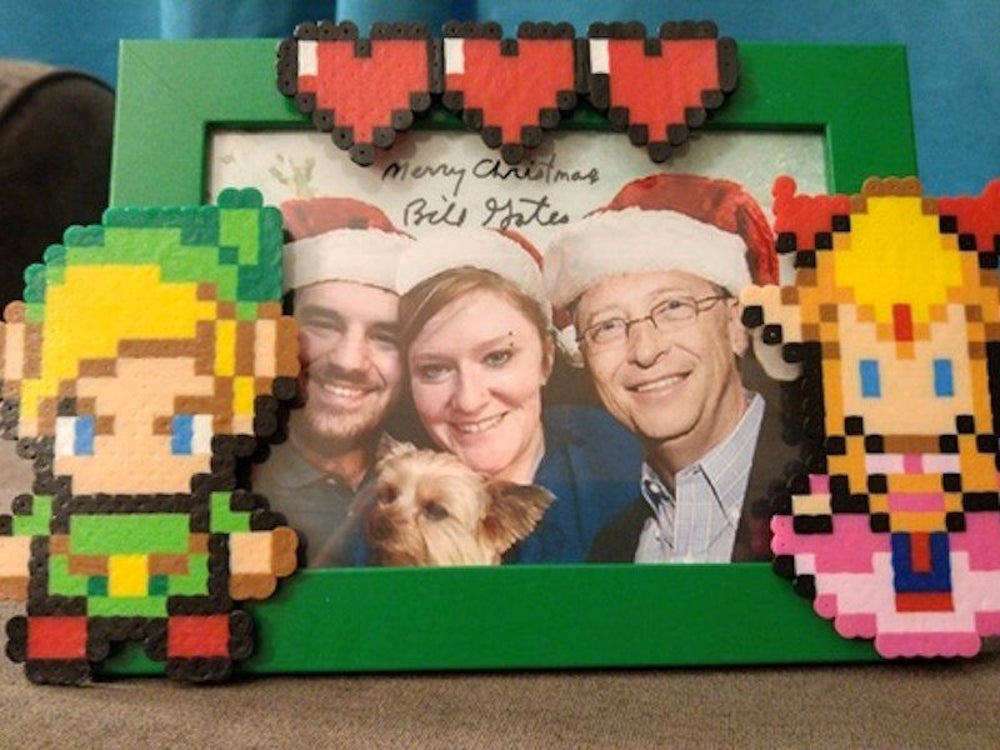"But the funniest gift in the box was a beaded Zelda-themed picture frame (he knew from her profile that she loves to bead). Inside the frame was a photo of her family with Gates added in. She wrote, ""The picture in it is just the best...he used my profile picture on here of me, my husband, and my dog, PHOTOSHOPPED HIMSELF IN, and put Santa hats on all of us! Come on now, that is the cutest thing!"""
