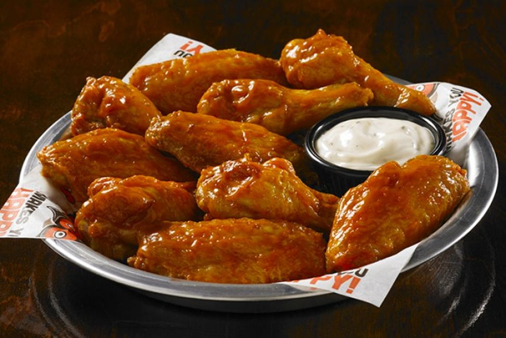 Eat some free wings at Hooters -- if you're single.