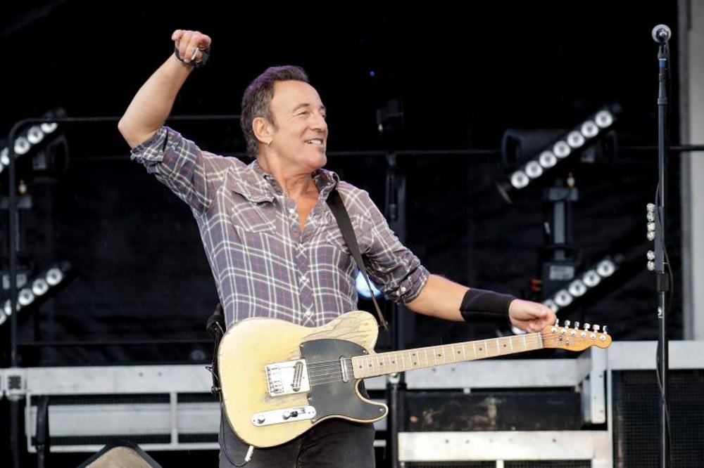 Bruce Springsteen invites a fan to play onstage.