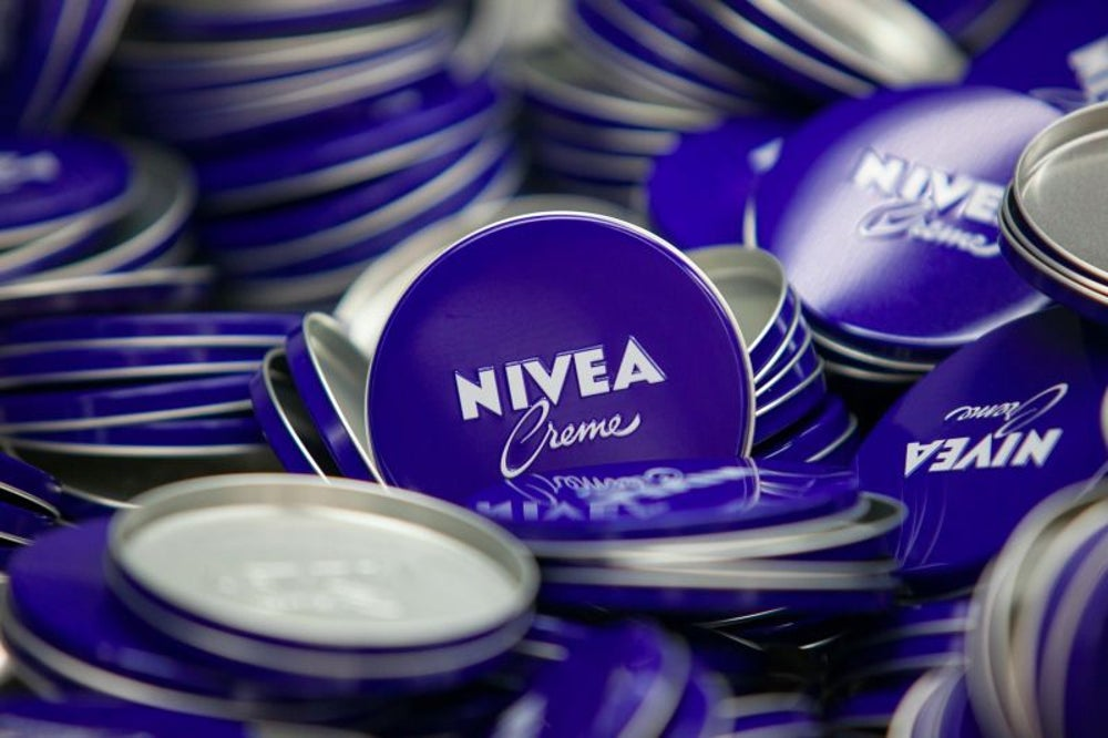 "Nivea ad campaign says ""White is purity."""