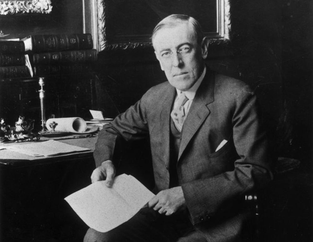 Woodrow Wilson signs Harrison Narcotics Tax Act in 1915.