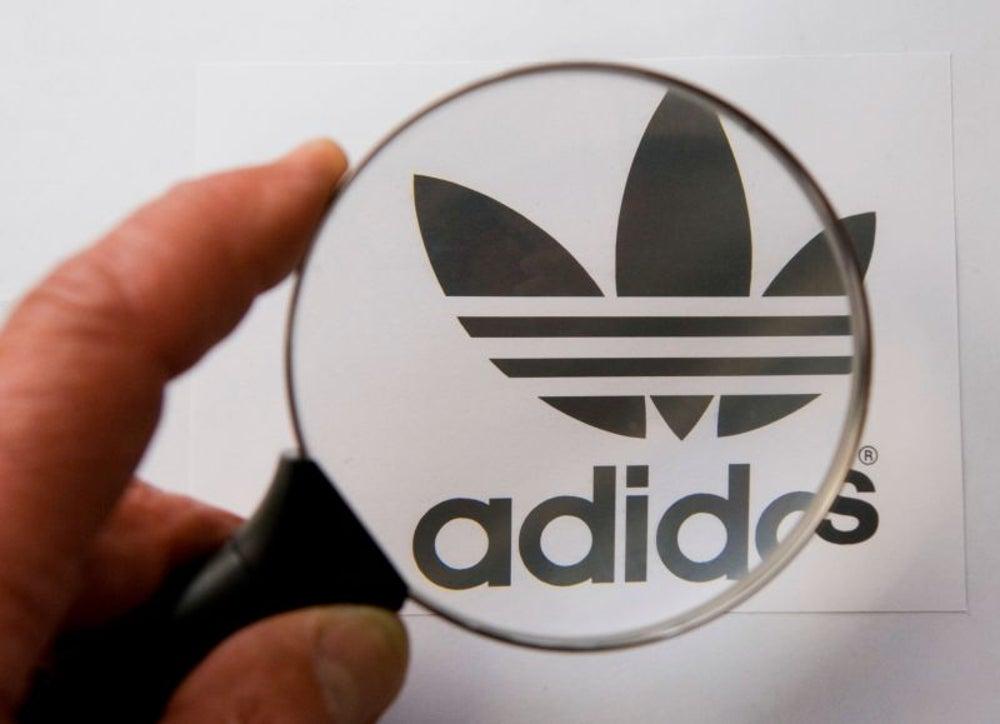 "Adidas congratulates runners who ""survived"" the Boston Marathon."