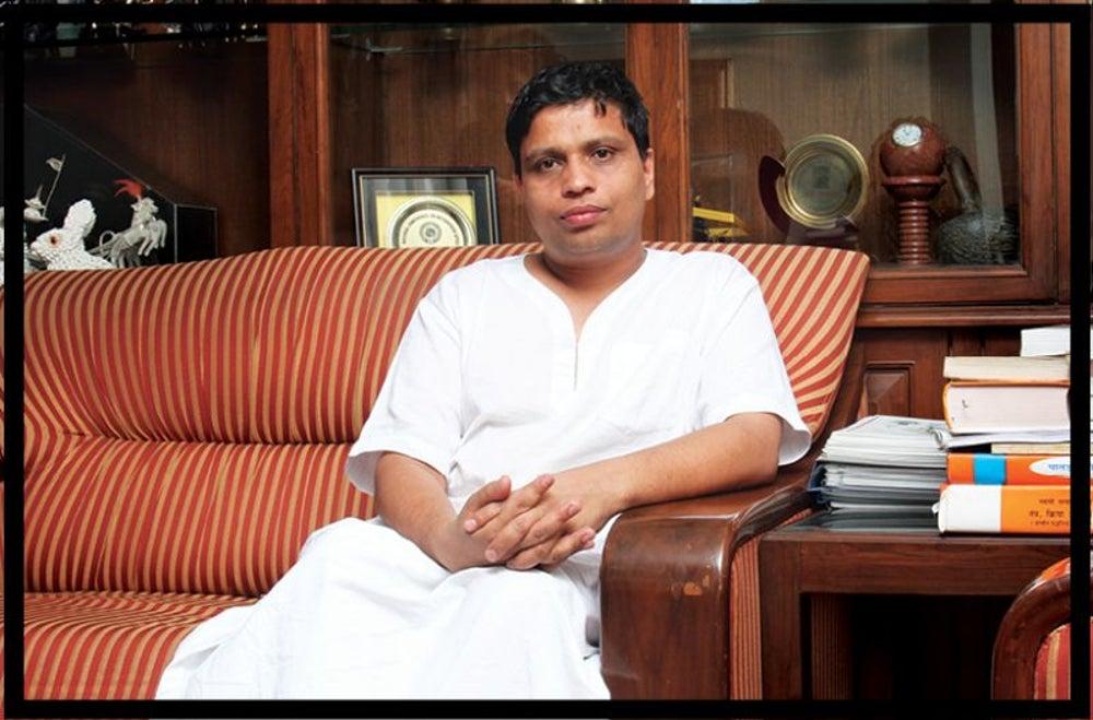 Kurta-dhoti Clad CEO of Patanjali Acharya Balakrishnan
