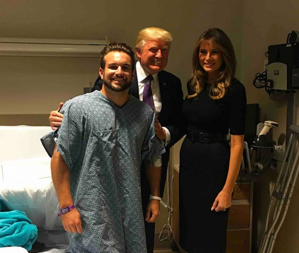 A victim of the Las Vegas shooting fights through his injuries to stand for the president.