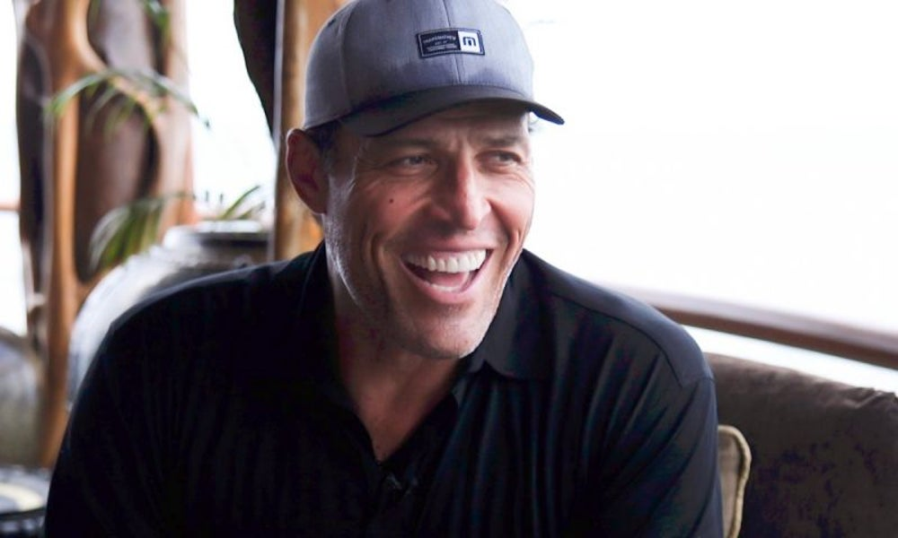 Life coach Tony Robbins pledges to provide another 100 million meals to the hungry through Feeding America.
