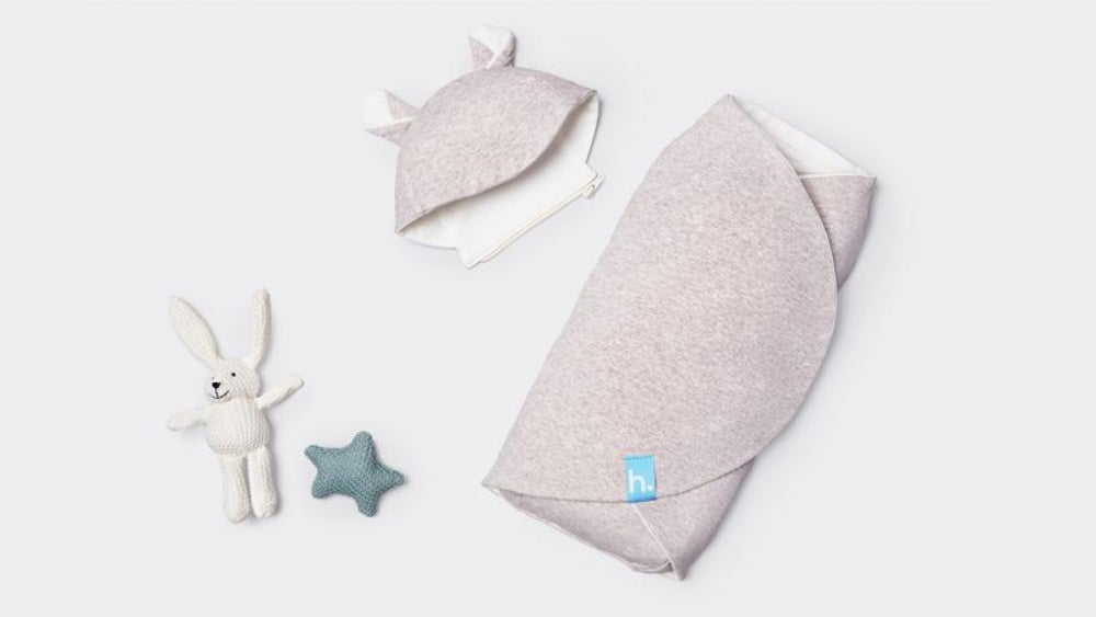 A multisensory baby swaddler that simulates a parent's embrace.
