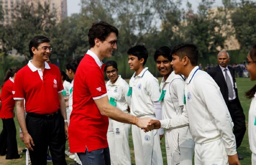 Trudeau Shaking Hands with Young Cricketers