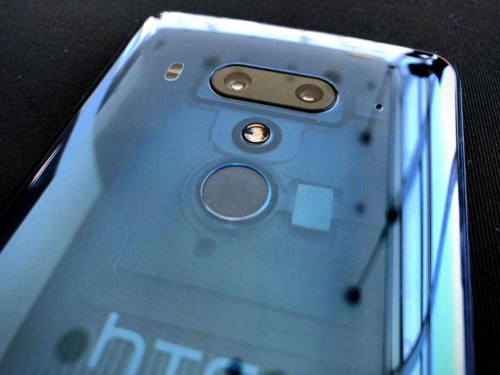 The translucent blue version is — you guessed it — translucent! You can see some of the components through the back of the phone.