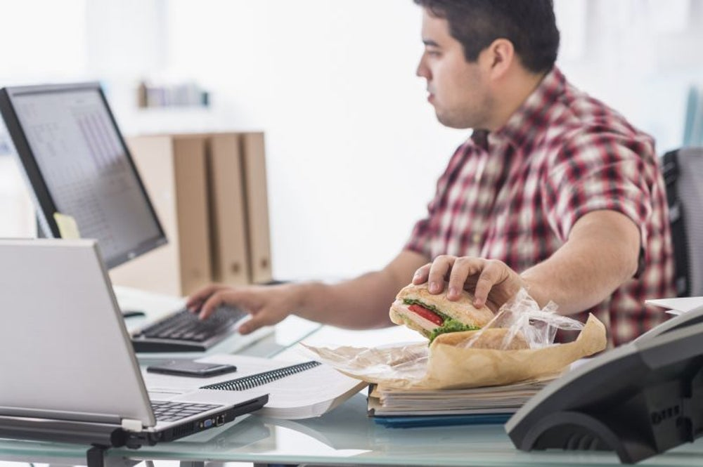 A man allegedly poisons his co-workers' lunches.