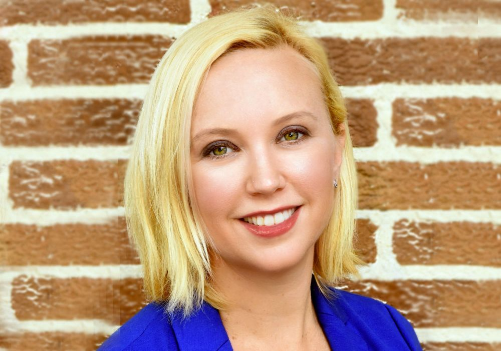 Mehryn Corrigan (Associate Director, Sharp Imaging and Information Company of America)