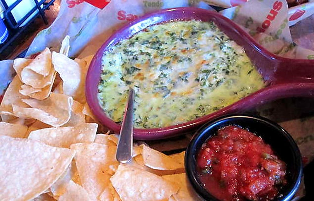 If you want to be full after an appetizer, get the Spinach and Artichoke Dip at Applebee's-- it has two and a half times as many calories as the same dish at Olive Garden.