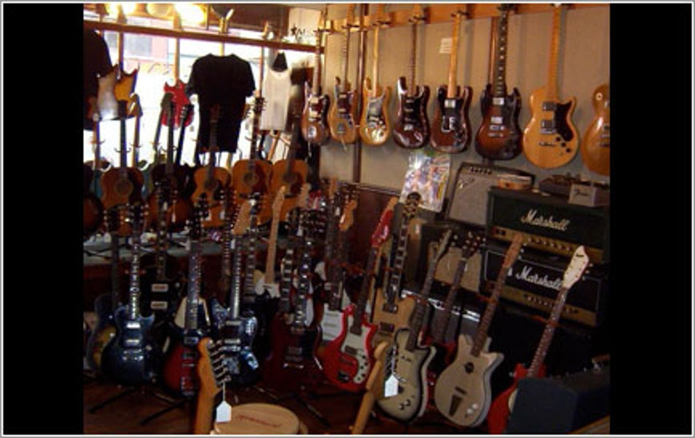 Guitarist Sells What He Knows Best