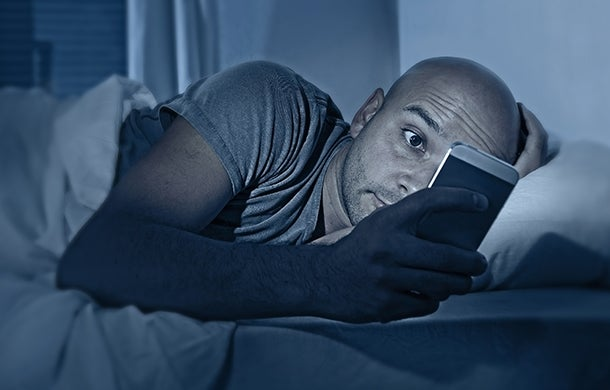 Man cuddling with phone