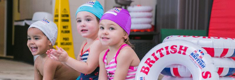 Three kids by a pool