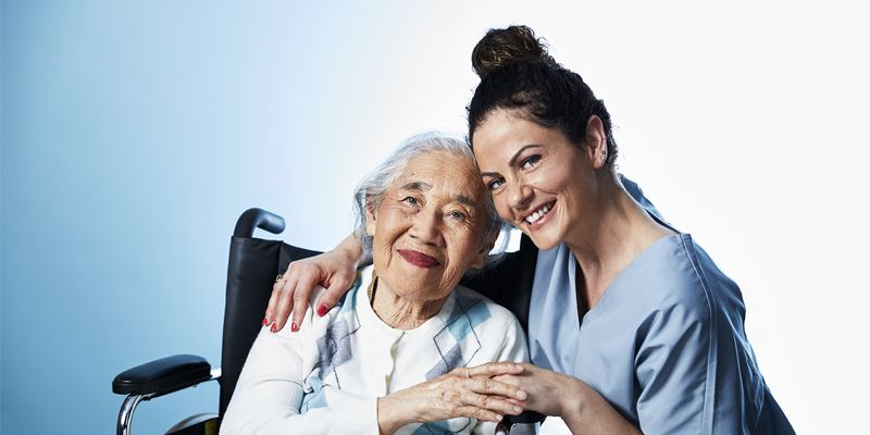 ComForCare - Caregiver and person in wheelchair
