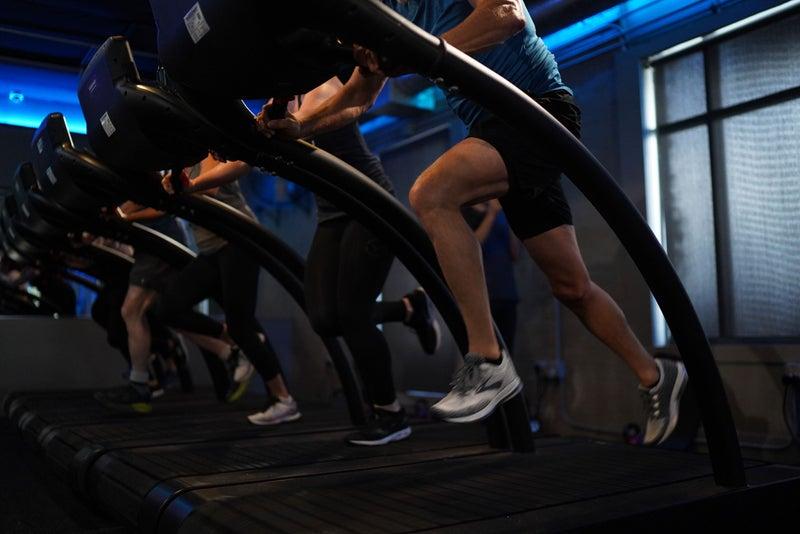 Stride Gym - People on stair machines.