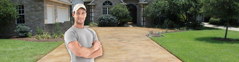 Concrete Technology - business owner in front of a new driveway