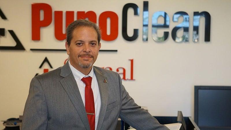 PuroClean employee in office