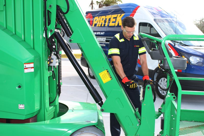 Pirtek technician working on equipment.
