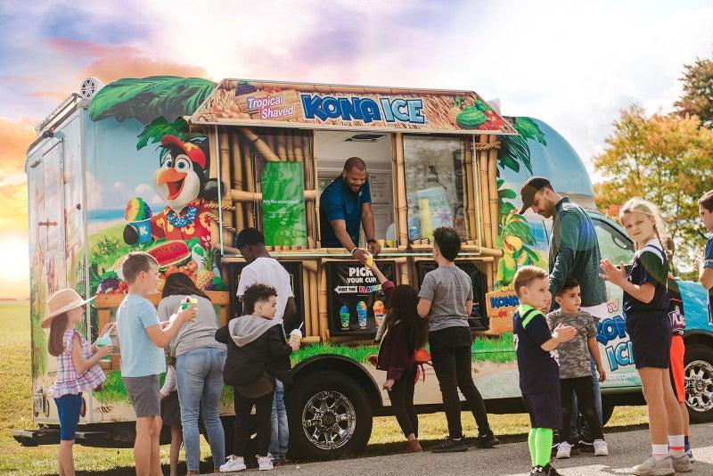 Kona Ice truck with customers