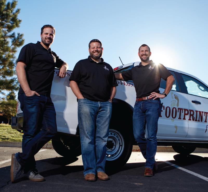 three men next to a truck