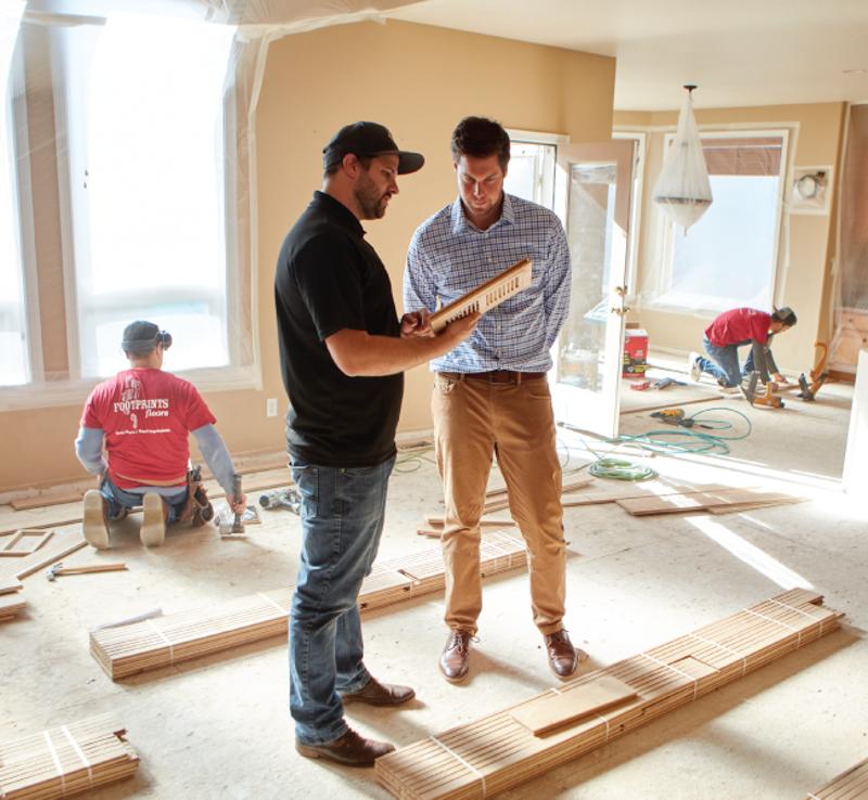 men installing floors